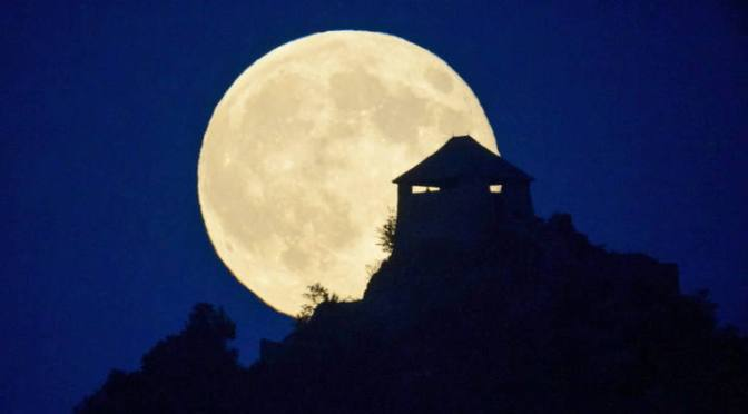 Supermoon above the castle of Somoskoujfalu in Budapest