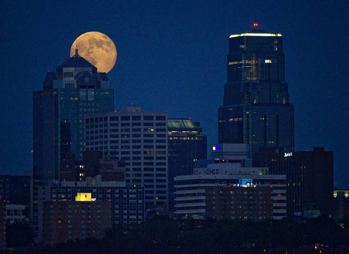 The Supermoon rises over downtown Kansas City, Missouri